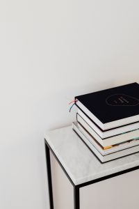 Kaboompics - Books On Marble Table, White Background