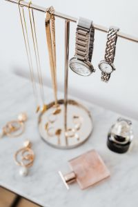 Kaboompics - Jewellery Stand on a Marble Table, White Background, pink perfumes