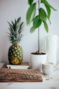 Kaboompics - Wooden keyboard, cup of coffee, pineapple and golden jewellery