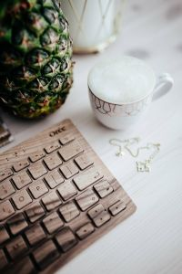 Kaboompics - Wooden keyboard, coffee and pineapple