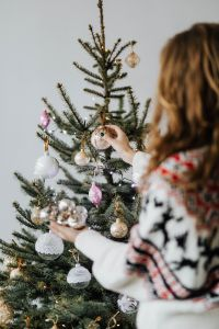 Kaboompics - Woman Decorate Christmas Trees