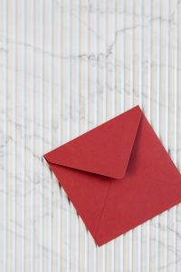 Kaboompics - Red envelope on marble