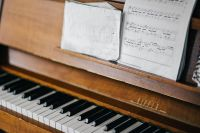 Kaboompics - Old piano with sheet music