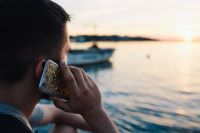 Kaboompics - Mobile phone in man's hands near the sea