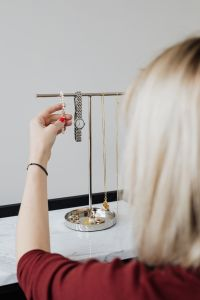 Kaboompics - Jewellery stand on marble & woman