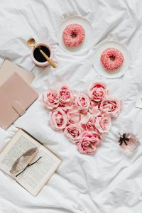 Kaboompics - Pink rosses - Coffee - Donuts - Book - Glasses - Heart