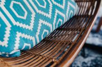 Kaboompics - Closeup of blue pillow and rattan chair