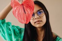 Kaboompics - A Beautiful Young Mixed Race Girl with Anthurium Flower