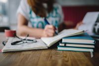 Kaboompics - Woman writing in her notebook