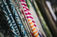 Kaboompics - Collection of design fabrics on hangers
