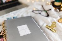 Kaboompics - Planners & organizers in bed - women's home office