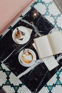 Kaboompics - Book coffee and cake with meringue and whipped cream on black marble