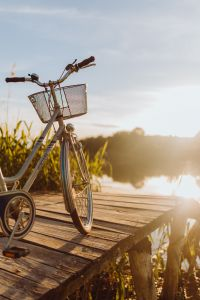 Kaboompics - Bicycle with basket on the pier in bright sunset light