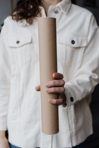 Kaboompics - Woman with Paper Tube