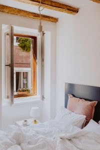 Kaboompics - White bedroom interior with window, coffee and small lamp on side table