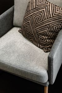 Grey armchair and pillow
