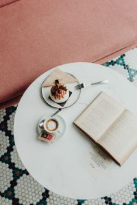 Kaboompics - Opened book, meringue with whipped cream and coffee on white marble