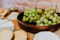 Cheese, white wine and grapes