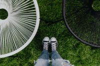 Kaboompics - Woman, jeans, sneakers, garden chairs, green grass