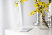 Kaboompics - White smartphone with yellow flowers
