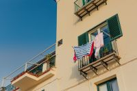 Kaboompics - Typical Italian balcony in an old house with drying laundry
