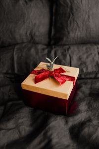 Christmas gifts on black linen bedding
