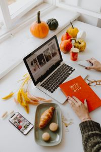 Kaboompics - Female desk with orange notebook and pumpkins