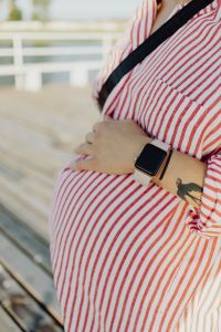 Kaboompics - A pregnant woman with a smartwatch on her hand