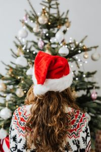 Kaboompics - Woman in Santa Hat, Christmas Tree Background