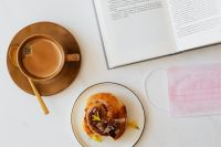 Kaboompics - Coffee - book - cinnamon roll - medical face mask