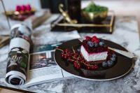 Kaboompics - Cheesecake and magazine on a marble table