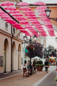 Kaboompics - Hundreds of Floating Pink Umbrellas Above a Street