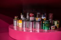 Kaboompics - Arrangement of tin cans on a pink background