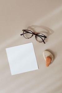 Kaboompics - Blank card & rock-glasses on beige background