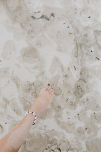 Kaboompics - female foot on the beach