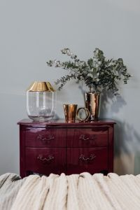 Kaboompics - Cabinet with gold decorations and eucalyptus