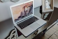 Kaboompics - Silver Apple MacBook Pro on a shiny table