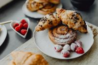 Croissants, puff pastry, powdered sugar and raspberries