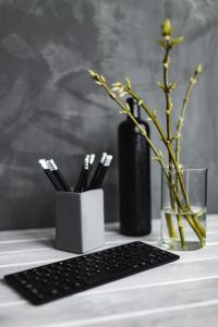 Kaboompics - Black keyboard with pencils on a white table
