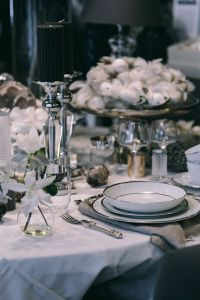 Kaboompics - Fancy restaurant dinner table decorated with quail eggs and feathers