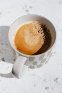Kaboompics - A cup of coffee on white marble