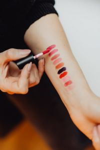 Kaboompics - Lipstick swatches on woman hand
