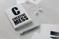 Kaboompics - Top view of black and white typography sentences, copy space, earphones, pen