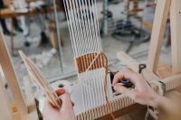 Kaboompics - Woman working on a loom