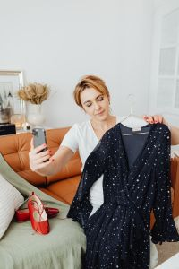 Kaboompics - Woman takes photos of products she will sell online - dress